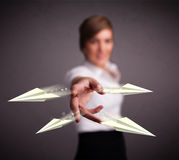 Beautiful lady throwing origami airplanes Stock Images
