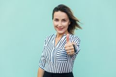 Beautiful lady thumbs up and looking at camera. Stock Photography