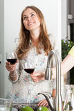 Beautiful lady during toasting kitchen party Stock Image