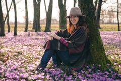 Spring.Crocuses.Forest.Fresh air. Inspiration. Female traveler Royalty Free Stock Image