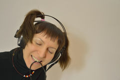 Beautiful lady with two tails near the microphone. The girl in earphones and microphone Stock Image