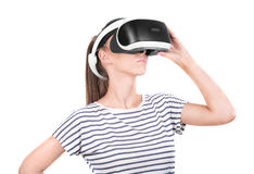 A beautiful lady in a virtual glasses, isolated on a white background. Video game simulation, 3d vision technology. Royalty Free Stock Photos