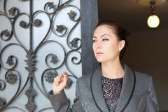 Beautiful lady waiting at the door Stock Photography