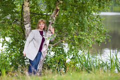 Beautiful lady walking at a lake shore Royalty Free Stock Image