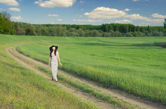 Beautiful lady walking in nature on sunny spring day Stock Photos