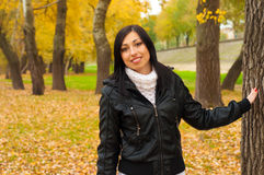 Beautiful lady walking in the park Royalty Free Stock Photos
