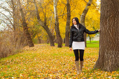 Beautiful lady walking in the park on cloudy day Royalty Free Stock Photos