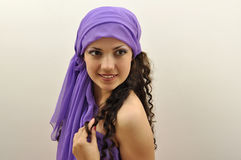 Beautiful lady wearing lilac silk scarf Royalty Free Stock Photos