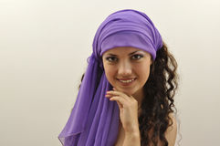 Beautiful lady wearing lilac silk scarf Stock Photo