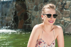 Beautiful lady wearing sun glasses and smiling Stock Photography