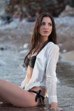Beautiful lady in wet shirt Royalty Free Stock Photography