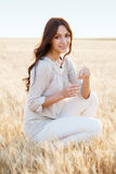 Beautiful lady in wheat field Stock Images