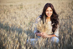Beautiful lady in wheat field Stock Photo