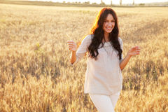 Beautiful lady in wheat field Royalty Free Stock Photography