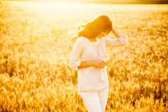 Beautiful lady in wheat field royalty free stock image