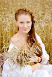 Beautiful  lady in wheat field. looking at camera Royalty Free Stock Photos