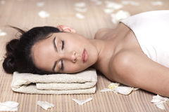 Beautiful lady with white flowers in spa treatment Stock Image