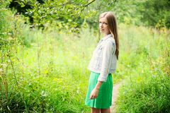 Beautiful lady in a wild forest Stock Photo