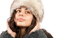 Beautiful lady in winter coat and hat. Beautiful young lady in winter coat and hat isolated on white background Royalty Free Stock Photo