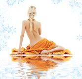 Beautiful Lady With Orange Towels On White Sand Stock Photo