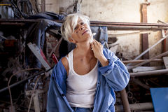 Beautiful lady at work in his old workshop Stock Photography
