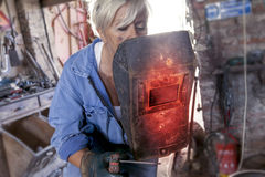 Beautiful lady at work in his old workshop Royalty Free Stock Photo