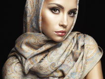 Beautiful lady wrapped in a shawl Stock Photography
