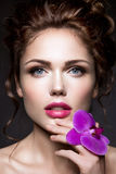 Beautiful lady with a wreath of flowers Stock Photography