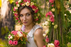 Beautiful lady in wreath of flowers. Stock Photos