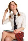 Beautiful lady writing on a worksheet. White background Stock Images