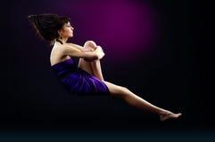 Beautiful lady and zero gravity. The portrait of a beautiful lady wearing a violet dress and zero gravity stock photo