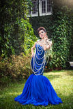 Beautiful ladyin luxury blue dress with pearl Royalty Free Stock Images