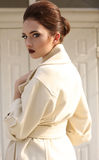 Beautiful ladylike woman with dark hair in luxurious wool coat Royalty Free Stock Photo