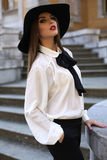 Beautiful ladylike woman in elegant blouse and felt hat Royalty Free Stock Photo
