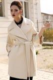 Beautiful ladylike woman in elegant wool coat posing on street Royalty Free Stock Photography