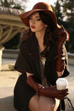 Beautiful Ladylike Woman In Elegant Coat And Hat Drinking Coffee Stock Images