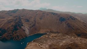 Beautiful lagoon in the mountains of Peru, aerial video