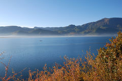 Beautiful lake. The beautiful lake, the day and the water are the same blue colors.here is the Chinese Sichuan is beautiful, original ecology Lugulake Stock Images