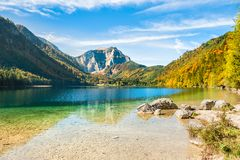 Beautiful lake in the Alps mountains in autumn. Vorderer Langbathsee lake in Austria Royalty Free Stock Photos