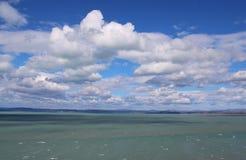 Beautiful Lake Balaton with white clouds. Beautiful Lake Balaton with clouds, view from Balatonvilagos royalty free stock photos