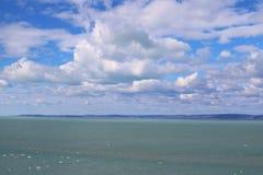 Beautiful Lake Balaton with many white clouds. Beautiful Lake Balaton with clouds, view from Balatonvilagos stock photos