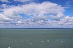 Beautiful Lake Balaton with many white clouds. Beautiful Lake Balaton with clouds, view from Balatonvilagos stock photo