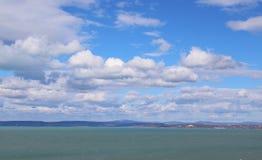 Beautiful Lake Balaton with white clouds. Beautiful Lake Balaton with clouds, view from Balatonvilagos royalty free stock photography