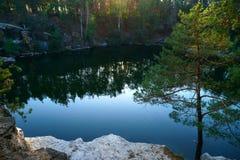 Beautiful lake at the bottom of the canyon at sunset. royalty free stock photo
