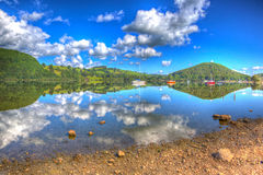 Beautiful lake with clear water and hills on a calm summer day Ullswater the Lake District England in colourful HDR. Beautiful lake with clear water and hills on Royalty Free Stock Image