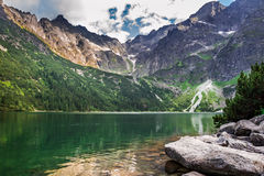 Beautiful lake with clear water in the mountains Stock Images