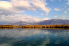 Beautiful lake and cloud scape. A beautiful lake scape with clouds in the small Prespa lake in Greece early in winter Royalty Free Stock Photos