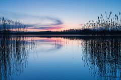 Beautiful lake with colorful sunset sky. Tranquil vibrant landscape Stock Photo