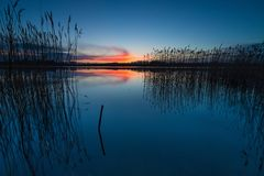 Beautiful lake with colorful sunset sky. Tranquil vibrant landscape Royalty Free Stock Photography