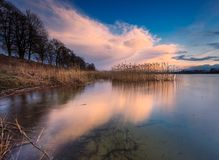 Beautiful lake with colorful sunset sky. Tranquil vibrant landscape Stock Photography